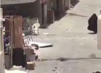شاهد بالفيديو : إمرأة بحرينية ترد على جنود الأمن روحوا اليمن شوفوا الحوثيين شو يسوون فيكم يا جبناء